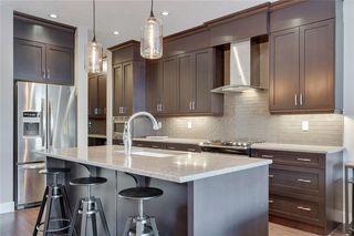 Photo 9: 206 20 Avenue NW in Calgary: Tuxedo Park Semi Detached for sale : MLS®# C4289673
