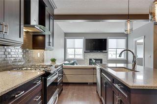 Photo 11: 206 20 Avenue NW in Calgary: Tuxedo Park Semi Detached for sale : MLS®# C4289673