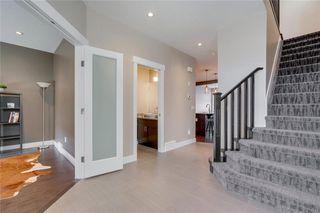 Photo 4: 206 20 Avenue NW in Calgary: Tuxedo Park Semi Detached for sale : MLS®# C4289673