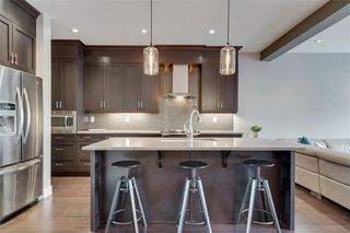 Photo 8: 206 20 Avenue NW in Calgary: Tuxedo Park Semi Detached for sale : MLS®# C4289673