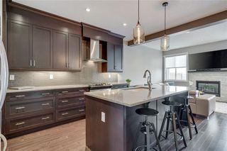 Photo 7: 206 20 Avenue NW in Calgary: Tuxedo Park Semi Detached for sale : MLS®# C4289673