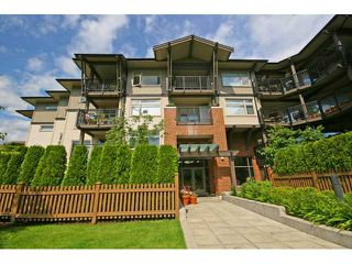 "Photo 1: 413 400 KLAHANIE Drive in Port Moody: Port Moody Centre Condo for sale in ""TIDES AT KLAHANIE"" : MLS®# V842063"