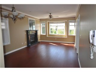 Photo 4: 4516 CLARENDON Street in Vancouver: Collingwood VE House for sale (Vancouver East)  : MLS®# V864818
