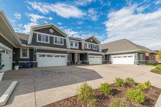 Photo 2: 46 RIVIERA Way: Cochrane Row/Townhouse for sale : MLS®# C4281559