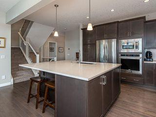 Photo 6: 46 RIVIERA Way: Cochrane Row/Townhouse for sale : MLS®# C4281559