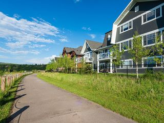 Photo 34: 46 RIVIERA Way: Cochrane Row/Townhouse for sale : MLS®# C4281559