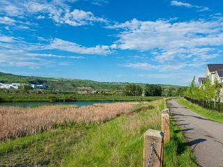Photo 35: 46 RIVIERA Way: Cochrane Row/Townhouse for sale : MLS®# C4281559