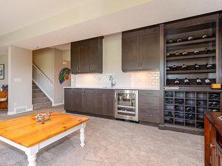 Photo 28: 46 RIVIERA Way: Cochrane Row/Townhouse for sale : MLS®# C4281559