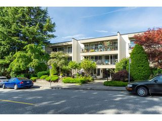 """Photo 1: 106 1351 MARTIN Street: White Rock Condo for sale in """"THE DOGWOOD"""" (South Surrey White Rock)  : MLS®# R2489161"""