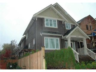 Photo 1: 1921 E 7TH Avenue in Vancouver: Grandview VE House 1/2 Duplex for sale (Vancouver East)  : MLS®# V858706