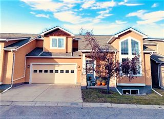 Main Photo: 34 Cedargrove Lane SW in Calgary: Cedarbrae Semi Detached for sale : MLS®# A1051957