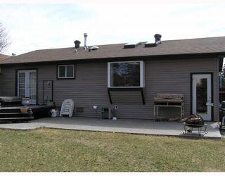 Photo 2: 9 GLENWOOD Bay: Cochrane Residential Detached Single Family for sale : MLS®# C3376080