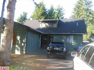 Photo 1: 12951 92A Avenue in Surrey: Queen Mary Park Surrey House for sale : MLS®# F1025332
