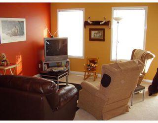 Photo 4: 3 135 BOW RIDGE Drive: Cochrane Townhouse for sale : MLS®# C3389240