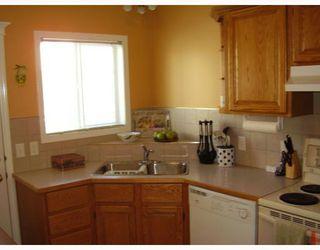 Photo 3: 3 135 BOW RIDGE Drive: Cochrane Townhouse for sale : MLS®# C3389240