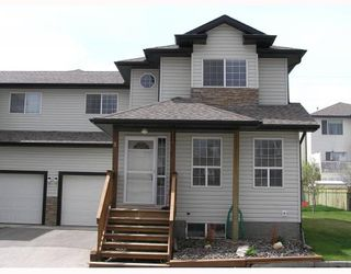 Photo 1: 3 135 BOW RIDGE Drive: Cochrane Townhouse for sale : MLS®# C3389240