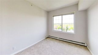 Photo 10: 403 8 PRESTWICK POND Terrace SE in Calgary: McKenzie Towne Apartment for sale : MLS®# A1011311
