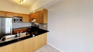 Photo 4: 403 8 PRESTWICK POND Terrace SE in Calgary: McKenzie Towne Apartment for sale : MLS®# A1011311