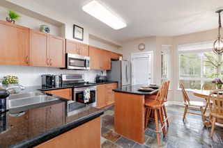 """Photo 2: 7 15 FOREST PARK Way in Port Moody: Heritage Woods PM Townhouse for sale in """"DISCOVERY RIDGE"""" : MLS®# R2436931"""