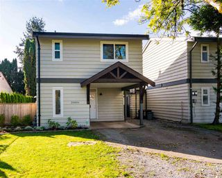 Photo 2: 20806 52A Avenue in Langley: Langley City 1/2 Duplex for sale : MLS®# R2518215
