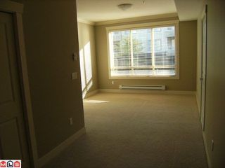 "Photo 4: 205 15368 17A Avenue in Surrey: King George Corridor Condo for sale in ""Ocean Wynde"" (South Surrey White Rock)  : MLS®# F1100152"