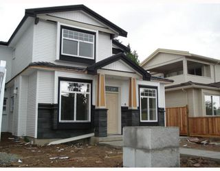 Photo 1: 7152 CANADA Way in Burnaby: Burnaby Lake House 1/2 Duplex for sale (Burnaby South)  : MLS®# V764368