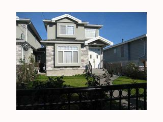Photo 1: 7092 SUSSEX Avenue in Burnaby: Metrotown 1/2 Duplex for sale (Burnaby South)  : MLS®# V792817