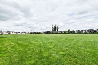 "Photo 33: 21038 77A Avenue in Langley: Willoughby Heights Condo for sale in ""IVY ROW"" : MLS®# R2474522"