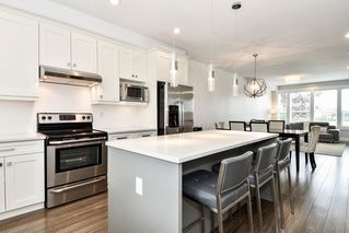 """Photo 8: 21038 77A Avenue in Langley: Willoughby Heights Condo for sale in """"IVY ROW"""" : MLS®# R2474522"""