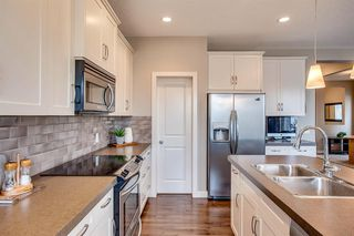 Photo 3: 56 BRIGHTONWOODS Grove SE in Calgary: New Brighton Detached for sale : MLS®# A1026524