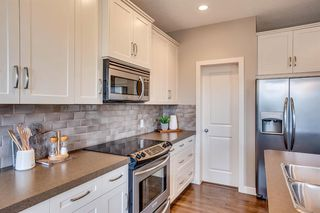Photo 4: 56 BRIGHTONWOODS Grove SE in Calgary: New Brighton Detached for sale : MLS®# A1026524