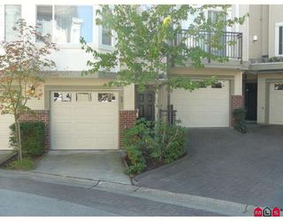 "Photo 1: 23 15450 101A Avenue in Surrey: Guildford Townhouse for sale in ""canterbury"" (North Surrey)  : MLS®# F2920871"