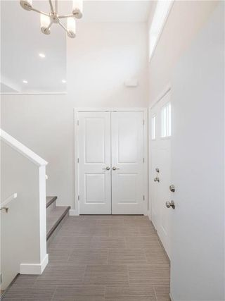 Photo 2: 8 Sand Piper Trail North in Landmark: R05 Residential for sale : MLS®# 202022708