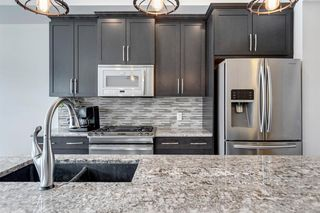 Photo 9: 109 MCKENZIE TOWNE Square SE in Calgary: McKenzie Towne Row/Townhouse for sale : MLS®# A1042511