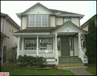 """Photo 1: 18560 64A Avenue in Surrey: Cloverdale BC House for sale in """"Clover Valley Station"""" (Cloverdale)  : MLS®# F1004081"""
