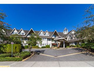 "Photo 1: 204 19241 FORD Road in Pitt Meadows: Central Meadows Condo for sale in ""VILLAGE GREEN"" : MLS®# R2428267"
