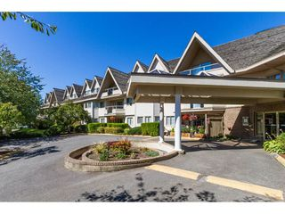 "Photo 2: 204 19241 FORD Road in Pitt Meadows: Central Meadows Condo for sale in ""VILLAGE GREEN"" : MLS®# R2428267"