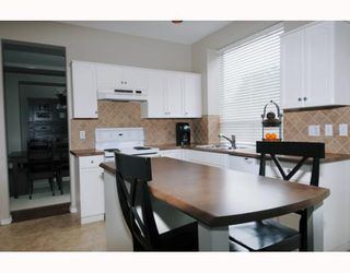 Photo 2: 1388 RHINE Close in Port Coquitlam: Riverwood House for sale : MLS®# V806686