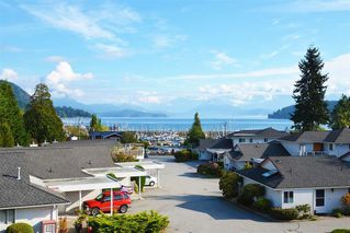 "Photo 1: 6 699 DOUGALL Road in Gibsons: Gibsons & Area Townhouse for sale in ""MARINA PLACE"" (Sunshine Coast)  : MLS®# R2391394"