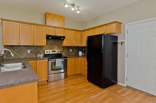 Photo 11: 205 2006 LUXSTONE Boulevard SW: Airdrie Row/Townhouse for sale : MLS®# A1010440