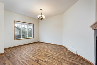 Photo 2: 135 100 COOPERS Common SW: Airdrie Row/Townhouse for sale : MLS®# A1014951