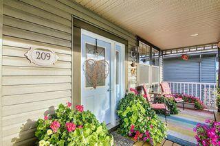 Photo 4: 209 Prestwick Estate Way SE in Calgary: McKenzie Towne Detached for sale : MLS®# A1058206