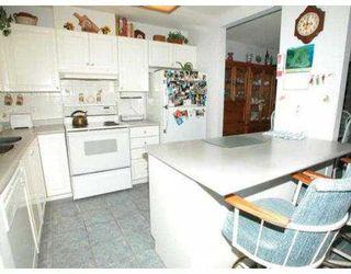 "Photo 2: 111 2968 BURLINGTON DR in Coquitlam: North Coquitlam Condo for sale in ""THE BURLINGTON"" : MLS®# V557169"