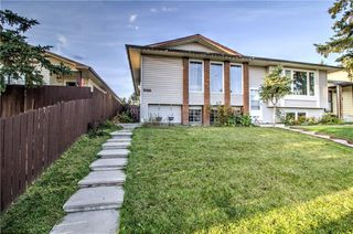 Photo 1: 3124 109 Avenue SW in Calgary: Cedarbrae Semi Detached for sale : MLS®# C4267965