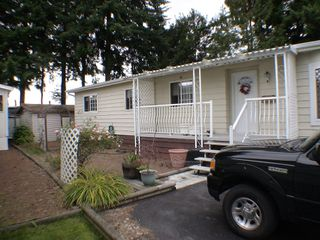 "Photo 1: 196 3665 244TH Street in Langley: Otter District Manufactured Home for sale in ""Langley Grove Estates"" : MLS®# F2825786"