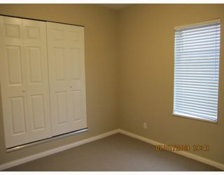 Photo 7: 7696 DAVIES Street in Burnaby: Edmonds BE House for sale (Burnaby East)  : MLS®# V775727
