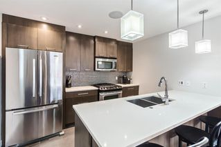 Photo 7: 2 3716 16 Street SW in Calgary: Altadore Row/Townhouse for sale : MLS®# A1026191