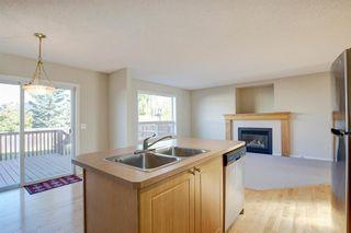 Photo 8: 350 Bridleridge Way SW in Calgary: Bridlewood Detached for sale : MLS®# A1039125