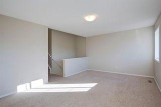 Photo 16: 350 Bridleridge Way SW in Calgary: Bridlewood Detached for sale : MLS®# A1039125