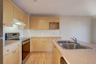 Photo 7: 350 Bridleridge Way SW in Calgary: Bridlewood Detached for sale : MLS®# A1039125